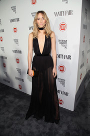 Suki Waterhouse took a daring plunge in a sheer, deep-V black gown by Balmain during the Fiat Young Hollywood celebration.