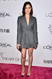 Aubrey Plaza chose a super-stylish gray Christian Dior skirt suit with pleated detail for the Vanity Fair Campaign Hollywood kickoff.