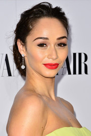 Cara Santana's bright red lipstick provided a striking contrast to her yellow dress.