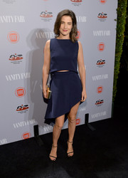 Cobie Smulders styled her top with a sassy blue asymmetrical skirt.