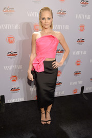 Laura Vandervoort teamed her crop-top with an elegant black pencil skirt.