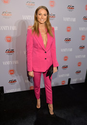 Stacy Keibler was eye candy at the Young Hollywood celebration in a bright pink Joseph pantsuit with no blouse underneath.