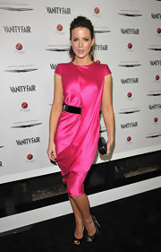 Kate Beckinsale paired her bright pink dress with satin peep-toe pumps.