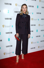 Laura Whitmore coordinated her look with a two-tone clutch.