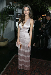 Emily Ratajkowski amped up the elegance with a white and gold box clutch.