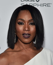 Angela Bassett wore her hair in a sleek side-parted cut during the Vanity Fair and FX Emmy nominations party.