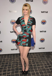 Lydia paired her printed mini dress with black satin platform pumps.
