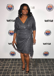 Octavia shined in a silver wrap dress. She accessorized with black slingbacks.