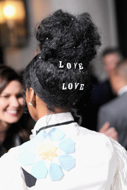 What's not to 'love love' about Janelle Monae's voluminous top knot during Vanity Fair's celebration of 'Hidden Figures'?
