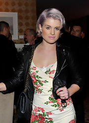 Showing off another inventive dye-job, Kelly Osbourne flaunted her new violet tinted hair-cut.