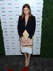 Kate Mara opted for a simple black blazer to pair with her floral and nude-toned skirt.