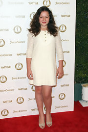Amara Miller looked perfectly youthful in this white lace shift dress for the Vanity Fair anniversary party.