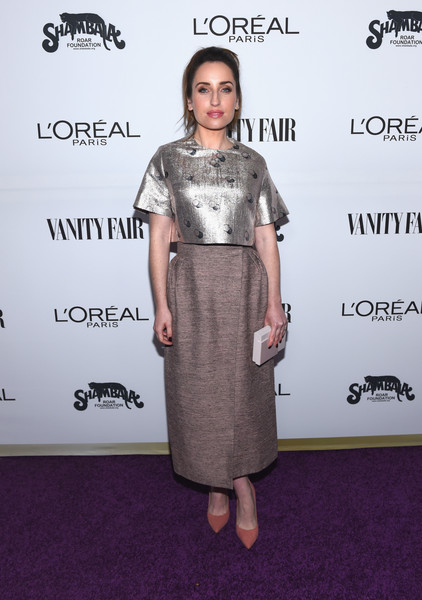 Zoe Lister Jones injected a subtle pop of color with a pair of dusty-pink pumps.