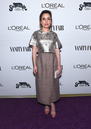 Zoe Lister Jones brought some shimmer to the purple carpet with this silver lamé crop-top by Vika Gazinskaya during the Toast to Young Hollywood event.