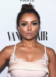 Kat Graham pulled her hair back into a stylish top knot for the Toast to Young Hollywood event.