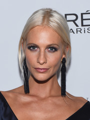 Poppy Delevingne styled her platinum-blonde locks into a loose, center-parted ponytail for the Toast to Young Hollywood event.