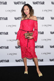 Aimee Song accessorized her look with a printed box clutch by Louis Vuitton.