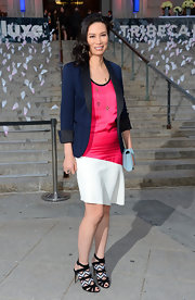 Wendi Deng Murdoch chose a pink and white mod-style frock for her evening look.