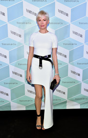 Michelle Williams rocked a white side-mullet dress by Louis Vuitton at the Vanity Fair and Tiffany & Co. dinner.