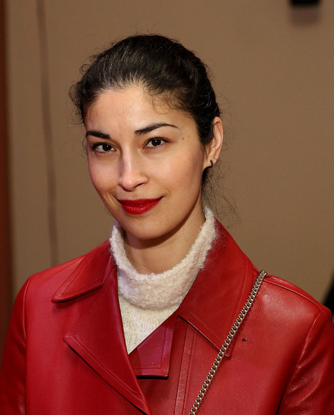 Caroline Issa wore her hair in a casual bun at the Vaquera fashion show.