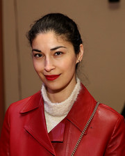 Caroline Issa's lipstick was a perfect match to her coat.
