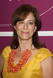 Jane Kaczmarek's orange statement necklace and yellow dress were a truly vibrant combination.
