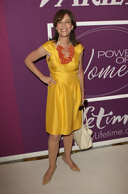 Jane Kaczmarek brought a bright pop of color to the Power of Women luncheon with her iridescent yellow dress.