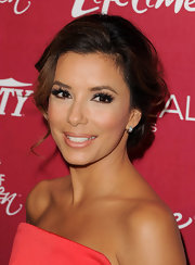 Eva Longoria brightened her smile with a shiny golden coral lipstick at the 'Variety' 3rd Annual Power of Women event.