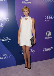 Charlize Theron looked sassy in a high-neck white mini dress by Stella McCartney at the Variety Power of Women event.