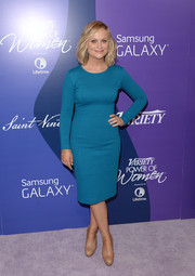 Amy Poehler went for classic sophistication in a long-sleeve teal sheath during the Variety Power of Women event.