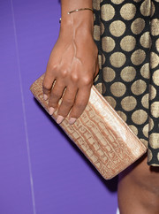 Kerry Washington added more shimmer to her look with this gold crocodile clutch when she attended the Variety Power of Women event.