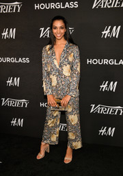 Chunky-heeled sandals finished off Corinne Foxx's ensemble.