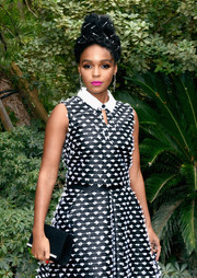 Janelle Monae teamed a black Giuseppe Zanotti suede clutch with embroidered separates for Variety's Creative Impact Awards.