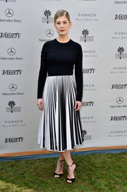 Rosamund Pike styled her no-frills top with a black-and-white pleated skirt, also by Proenza Schouler.