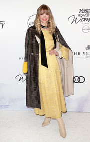 Jaime King layered a glen plaid coat by Fendi over a yellow maxi dress for Variety's Power of Women event.