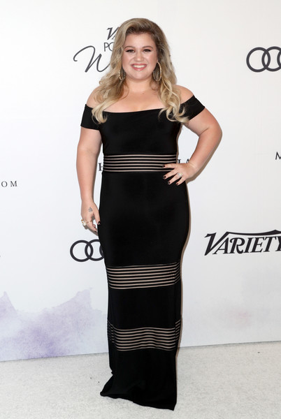 Kelly Clarkson slipped into a figure-hugging black off-the-shoulder dress with striped panels for Variety's Power of Women event.