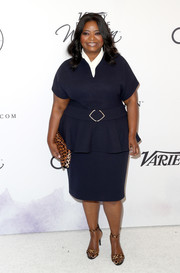 Octavia Spencer styled her dress with an animal-print clutch and matching sandals.