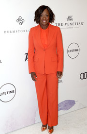 Viola Davis was hard to miss in her bright orange Armani pantsuit during Variety's Power of Women event.