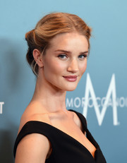 Rosie Huntington-Whiteley went for vintage glamour with this rolled updo when she attended Variety's Power of Women luncheon.