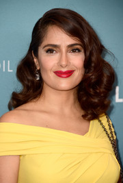 Salma Hayek's red lipstick made a lovely contrast to her yellow dress.
