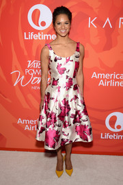 Misty Copeland was bold with her color choices, pairing her pink and white dress with mustard pumps.