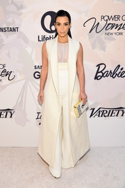 Kim Kardashian looked dramatic at the Variety Power of Women event in an all-white Narciso Rodriguez ensemble, consisting of a sleeveless ankle-length coat and high-waisted, flared slacks.