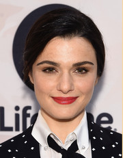 Rachel Weisz's red-hot smile totally lit up her pretty face.