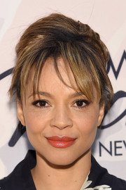 Carmen Ejogo wore her hair in a loose bun with wispy bangs during the Variety Power of Women event.