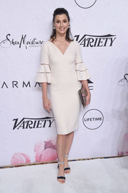 Bridget Moynahan styled her dress with a pair of black and silver ankle-strap sandals.