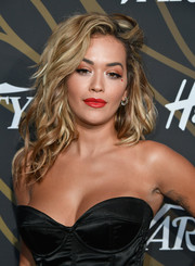 Rita Ora swiped on some bright red lipstick for a pop of color to her black outfit.