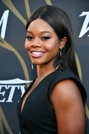 Gabrielle Douglas opted for a sleek center-parted hairstyle when she attended the Variety Power of Young Hollywood event.