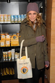 AnnaLynne McCord kept warm at Sundance in an olive double breasted coat.