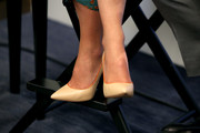 Olivia Wilde visited the Variety Studio wearing classy nude pointy pumps with orange edging.