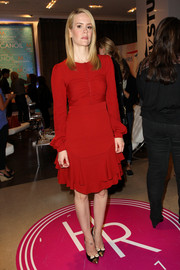 Sarah Paulson looked regal in a long-sleeve red cocktail dress during her visit to the Variety Studio.